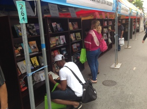 Book lovers peruse new titles at the Author Solutions gallery at the Miami Book Fair